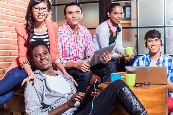Group of diversity college students learning on campus Stock photo © Kzenon