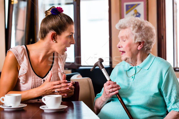 Stock photo: Granny and granddaughter at argument in cafe