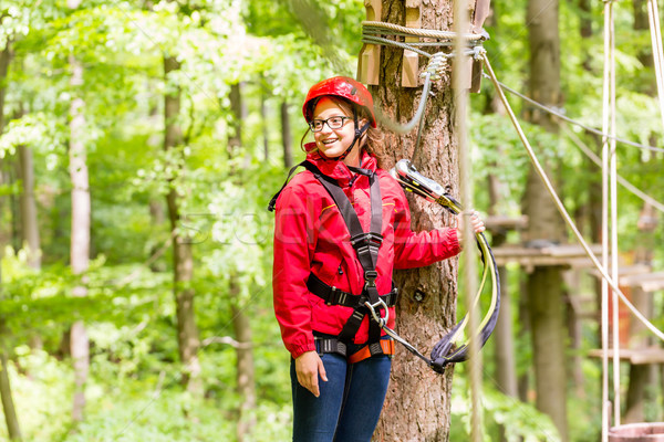 Stock photo: Child reaching platform climbing in high rope course