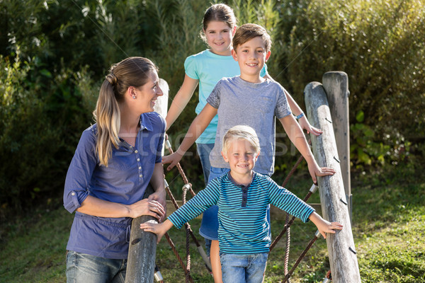 Family with kids playing on adventure playground Stock photo © Kzenon