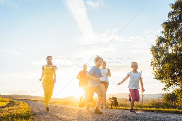 Juguetón familia ejecutando jugando camino verano Foto stock © Kzenon