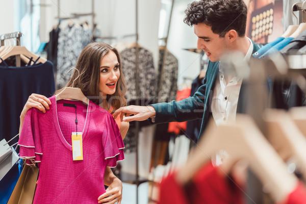 Woman and man checking price tag of dress Stock photo © Kzenon