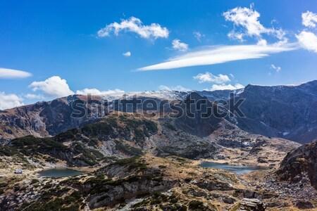 Kilátás hét tó régió hegyek felhők Stock fotó © Kzenon
