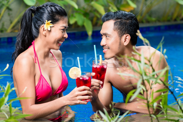 Couple having drinks in pool in Asia Stock photo © Kzenon