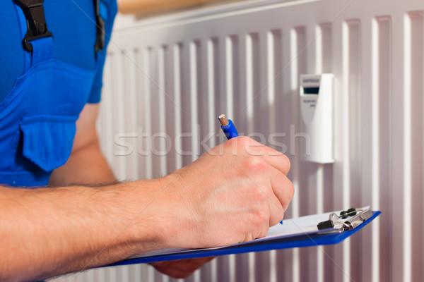 Technician reading the heat meter Stock photo © Kzenon