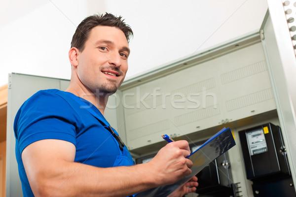 Technician reading the electricity meter Stock photo © Kzenon