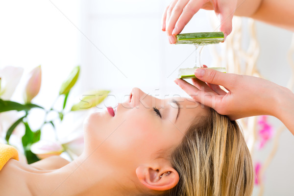 Wellness - woman having aloe vera application Stock photo © Kzenon