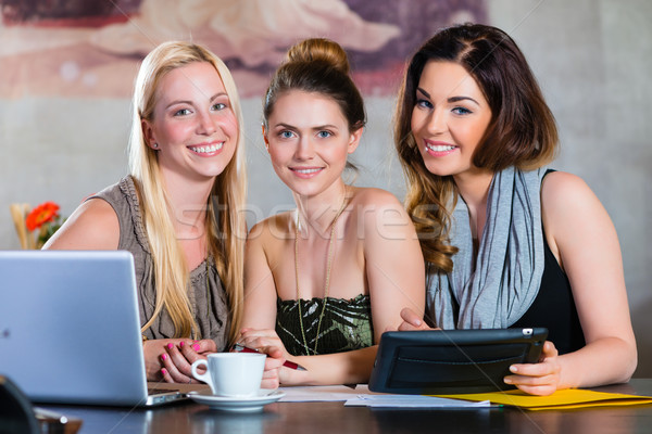 Students or businesswomen working in cafe Stock photo © Kzenon