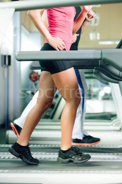 Insanlar ayak değirmeni spor salonu çalışma kadın adam Stok fotoğraf © Kzenon