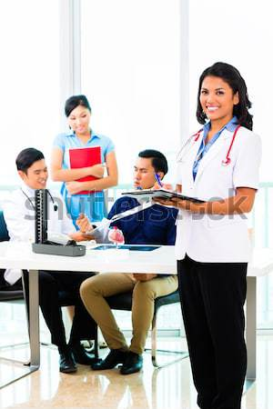 Asian doctor check-up blood pressure on patient Stock photo © Kzenon