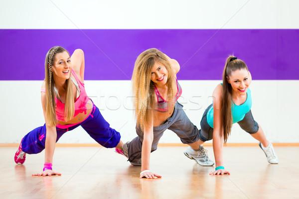 Stock photo: Dancer at Zumba fitness training in dance studio