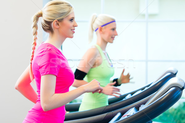 Nők tornaterem sport futópad fitnessz fut Stock fotó © Kzenon