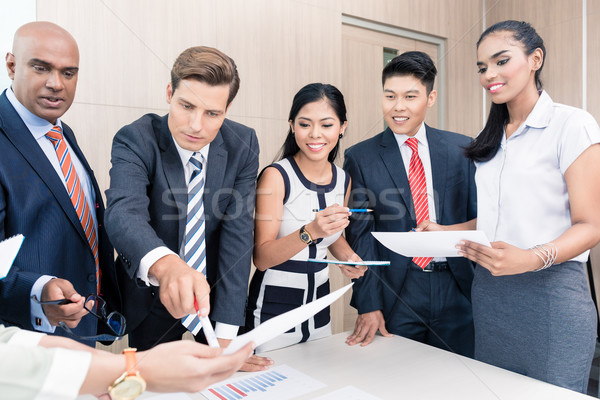 Business team discussing graphs and numbers in meeting Stock photo © Kzenon