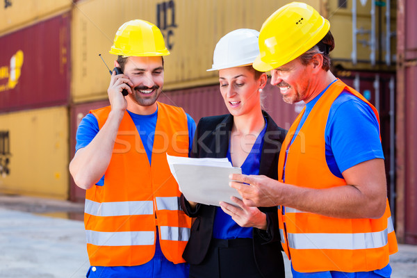 Worker and manager of shipment company discussing Stock photo © Kzenon