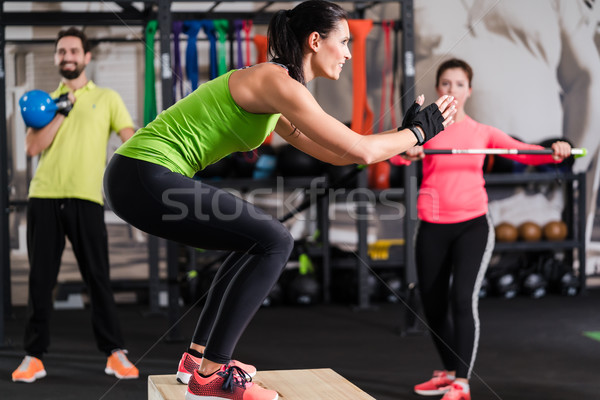 Group of men and woman in functional training gym Stock photo © Kzenon