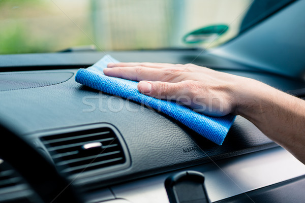 Man wiping the dashboard of his car Stock photo © Kzenon