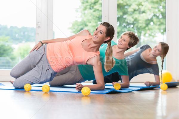 Women doing exercises for pelvis floor in postnatal regression c Stock photo © Kzenon