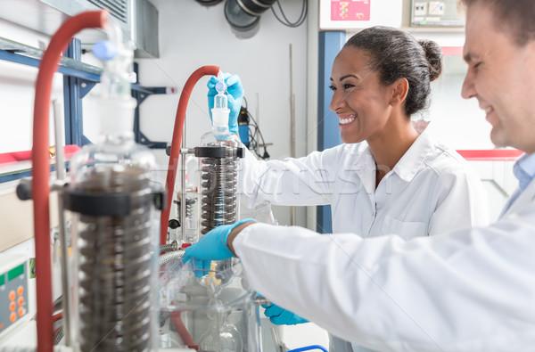 испытание научный лаборатория человека женщины работу Сток-фото © Kzenon