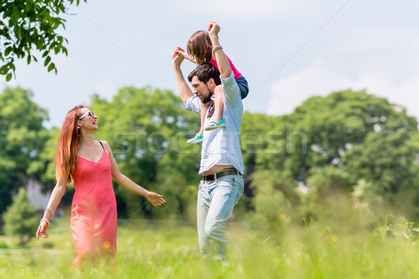 Family walk - Father carrying kid on his shoulder Stock photo © Kzenon