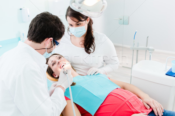 Dentiste femme patient forage dents médecin Photo stock © Kzenon