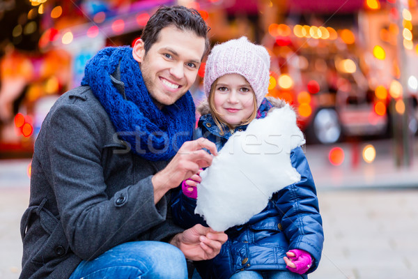 Father on Christmas market buying sweets for child Stock photo © Kzenon