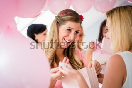 Pregnant woman opening present box on baby shower Stock photo © Kzenon