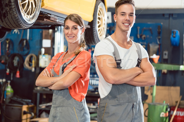Portrait of two skilled auto mechanics looking at camera with confidence Stock photo © Kzenon