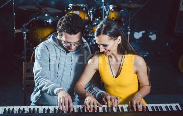 Piano teacher giving music lessons to his student Stock photo © Kzenon