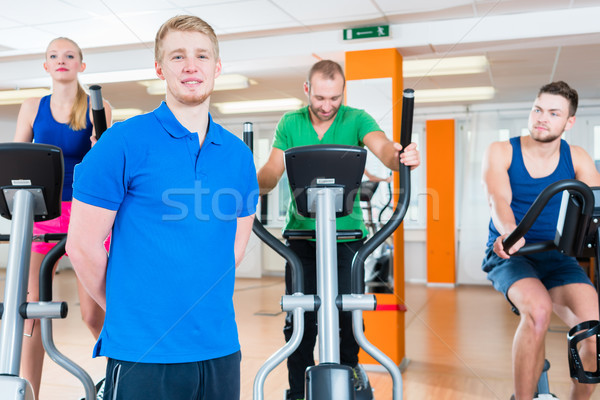 Physiotherapist and his encounter group during spinning in gym Stock photo © Kzenon
