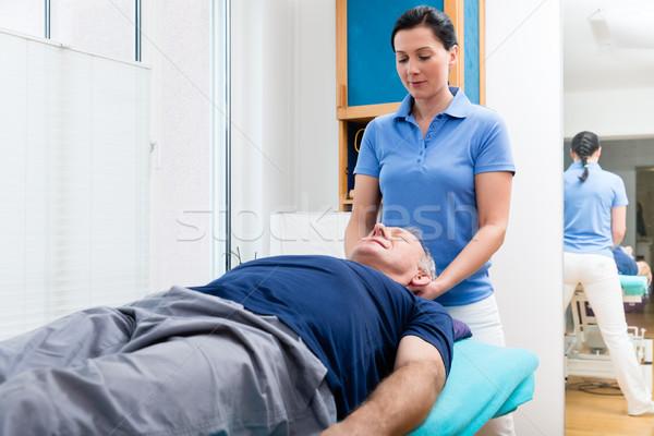 Senior man visiting physiotherapist for massage Stock photo © Kzenon