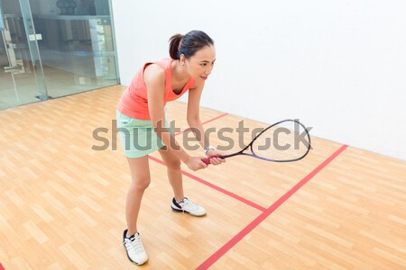 Competitive Chinese woman holding the racquet during a squash game Stock photo © Kzenon