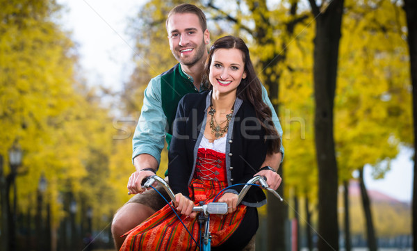 Couple in Dirndl and Leather trousers together on a bike Stock photo © Kzenon