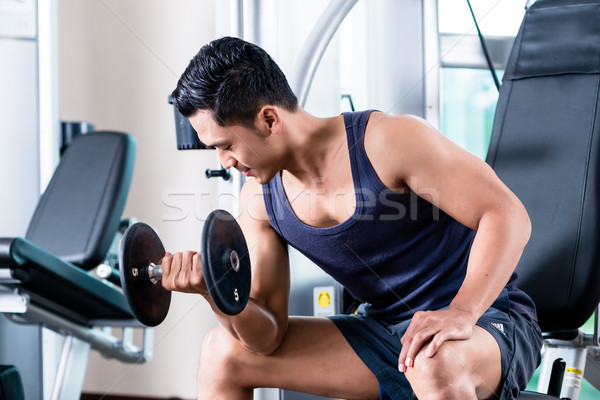 Man working out in gym Stock photo © Kzenon