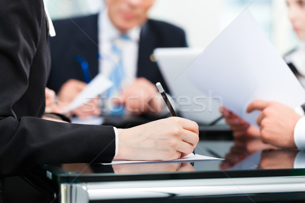 Business meeting with work on contract Stock photo © Kzenon