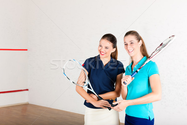 Squash racket sport in gym, women training Stock photo © Kzenon