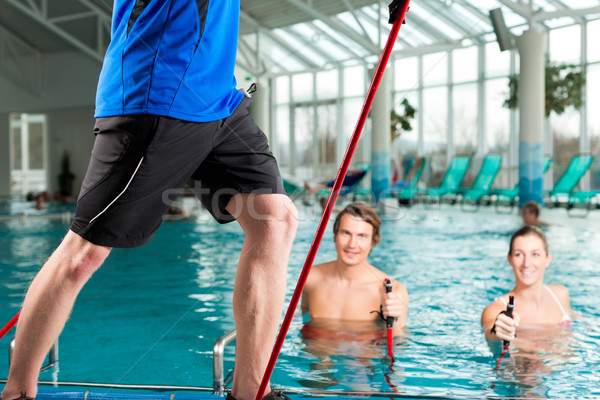 Fitness - sports gymnastics under water in swimming pool Stock photo © Kzenon