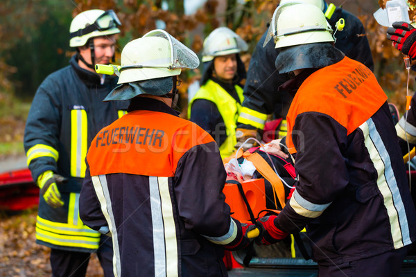Accident - Fire brigade, Victim with respirator Stock photo © Kzenon