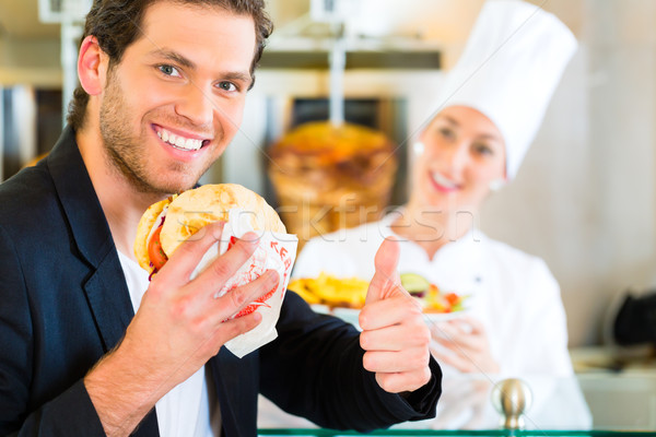 Stock photo: Kebab - customer and hot Doner with fresh ingredients