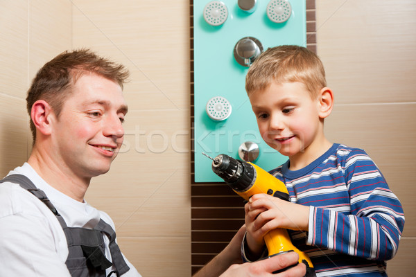 Plumber installing a mixer tap in a bathroom Stock photo © Kzenon