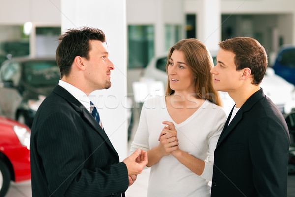 Couple with salesman at car dealer  Stock photo © Kzenon