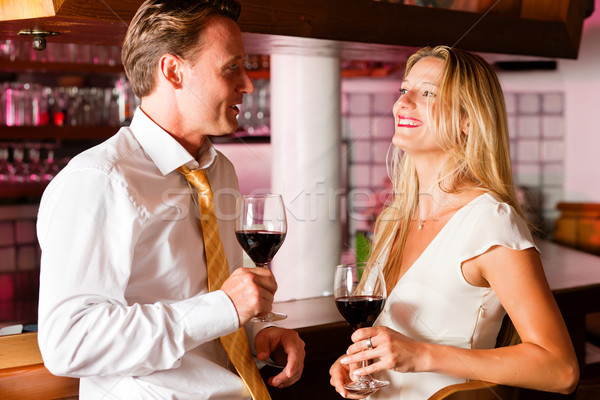Casual Businesspeople flirting in hotel bar Stock photo © Kzenon