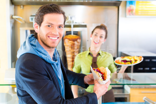 Kebab - customer and hot Doner with fresh ingredients Stock photo © Kzenon