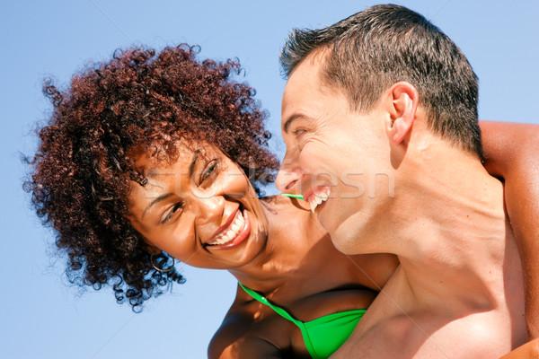 Yaz bikini kız erkek arkadaş çift sevmek Stok fotoğraf © Kzenon
