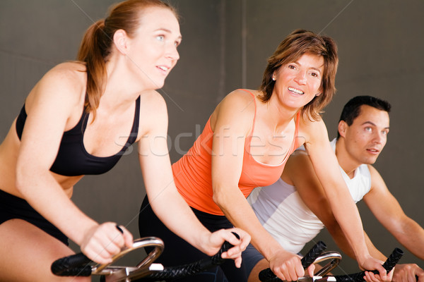Bicycle Spinning in gym Stock photo © Kzenon