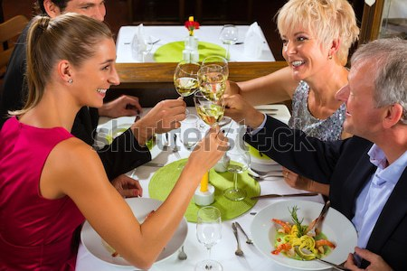 Stock photo: Senior couple eating dinner in restaurant