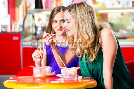 People in American diner or restaurant and waitress Stock photo © Kzenon