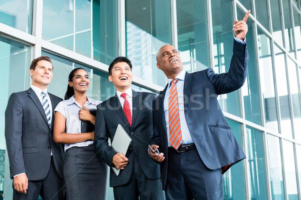 CEO with team explaining his leadership vision Stock photo © Kzenon
