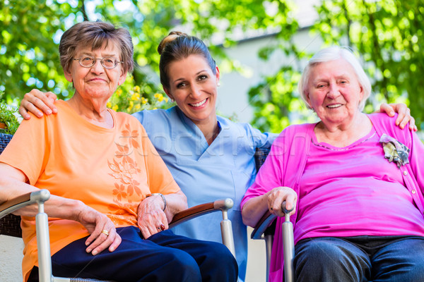 Geriatric nurse having chat with senior women Stock photo © Kzenon