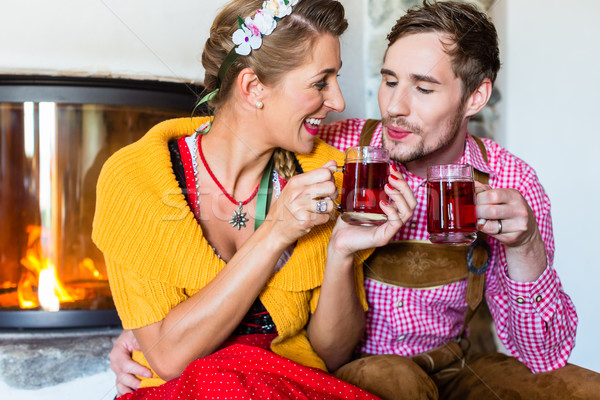 Man and woman drinking tea at fireplace in cabin Stock photo © Kzenon