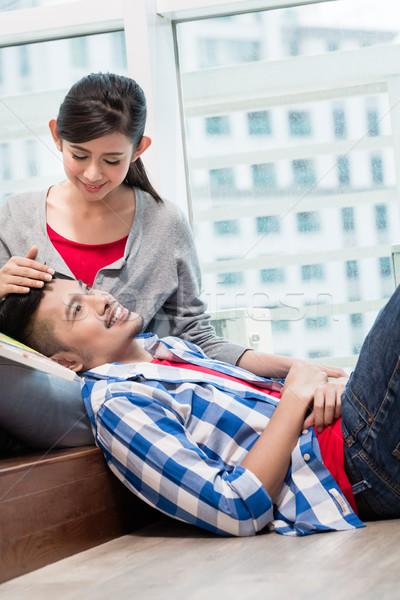 Asian girl caressing her boyfriend Stock photo © Kzenon